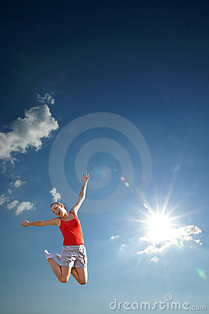 Young girl jumping in sky