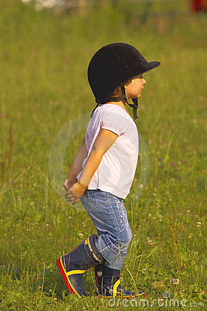 Child walking in the meadow