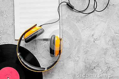 Compose music. Vinyl records, headphones, music notes on grey background top view copyspace