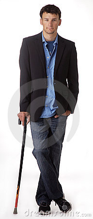Young man leaning on cane