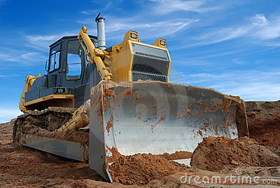 Heavy bulldozer standing in sandpit