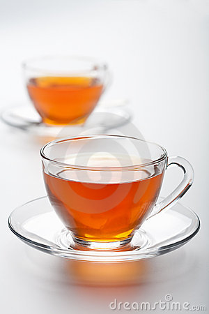 Two cups of tea over white background