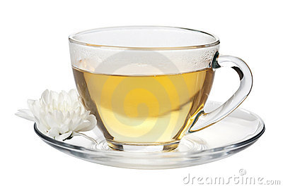 Cup of green tea and white flower isolated
