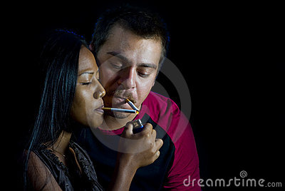 Couple is lighting their cigarettes