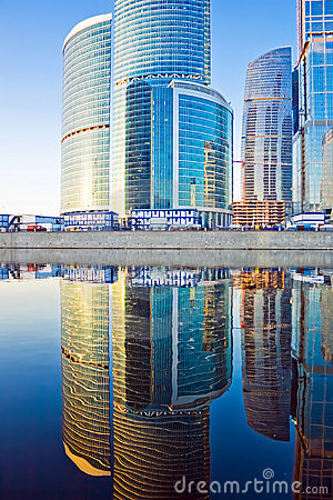 Business skyscrapers and reflections in the river
