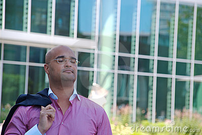 Businessman in front of glass building