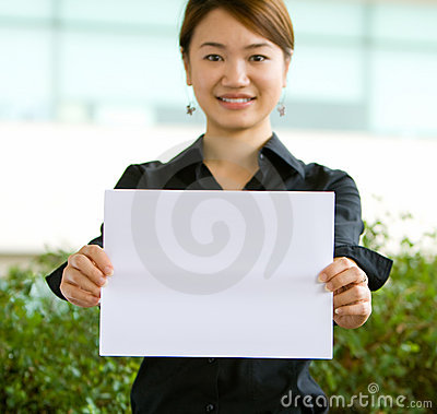 Asian business woman holding a blank paper