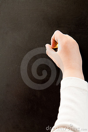 Hand writing on a blackboard