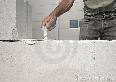 Bricklayer builds the wall
