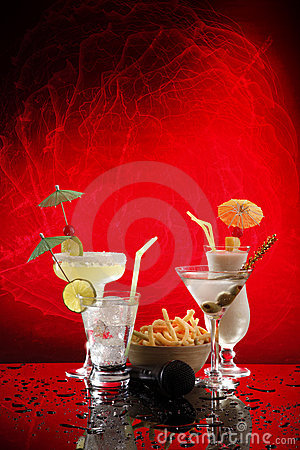 4 happy umbrella drinks on red with microphone
