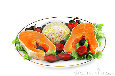 Two salmon steak on white dish