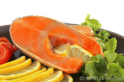 Two salmon steak on dark dish