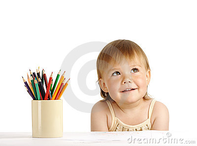 Child with bunch of color crayons