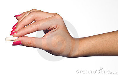 Woman hand with pill