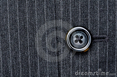 Button on a pin striped suit
