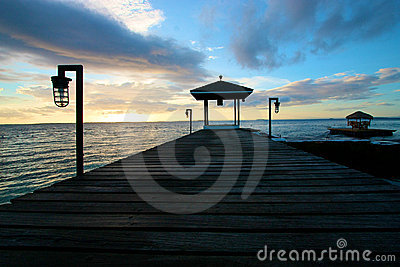 Silhouetted wooden pier