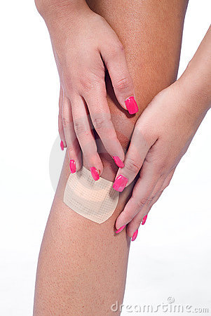 Woman knee with patch