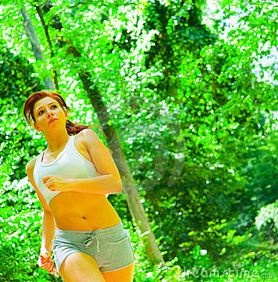 Woman Runner In The Woods