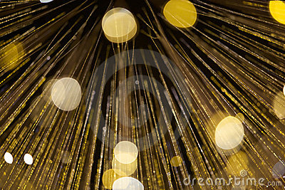 Strings of yellow-gold lights, abstract
