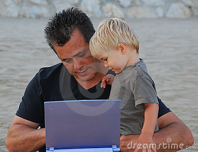 Man and son with computer