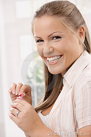 Happy girl with chewing gum