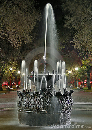 Old fountain at night in the park