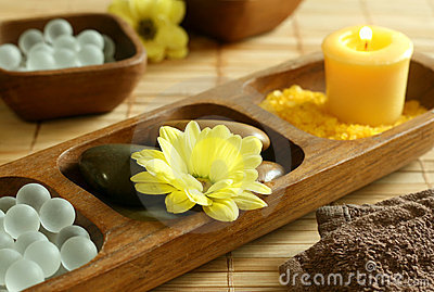 Bath salts, candle, stones, flower and towel.