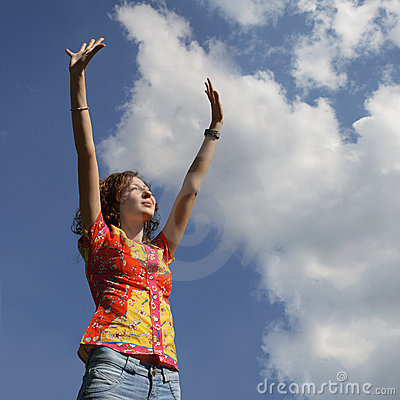 Young woman with hands up