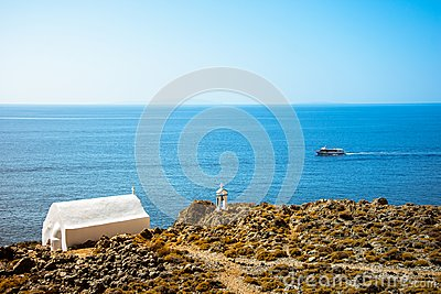 Bell tower and white church at Loutro, Chania, Crete.