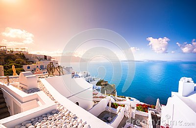 Oia town on Santorini island, Greece. Traditional and famous houses and churches with blue domes over the Caldera.