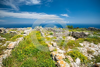 The ruins of ancient Thira, a prehistoric village at the top of the mountain Mesa Vouno, Santorini