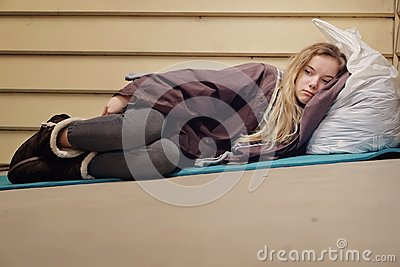 Homeless young teen taking shelter
