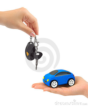 Hands with keys and toy car