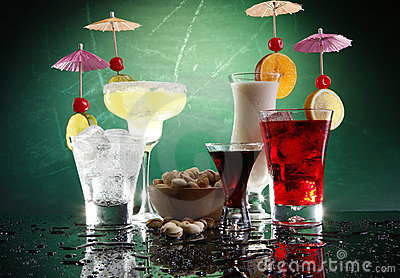4 happy umbrella drinks and pistachio