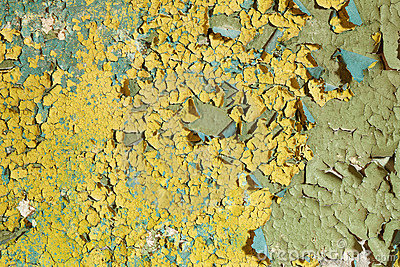 Old damaged yellow paint on a concrete wall
