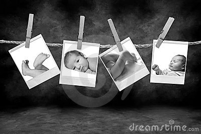 Black and White Photographs Hanging on a Rope By C
