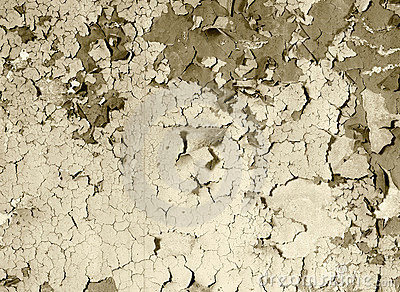 Old damaged paint on a concrete wall - sepia