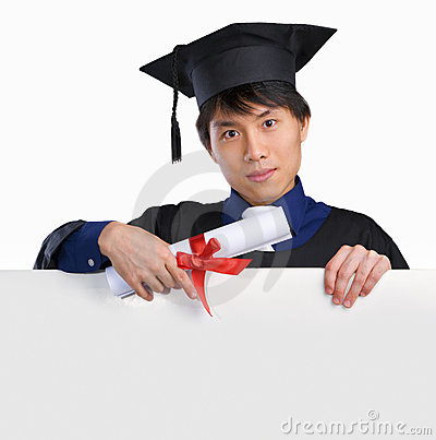 Graduated scholar pointing to white board