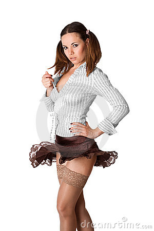 Cute young brunette girl in brown skirt dancing