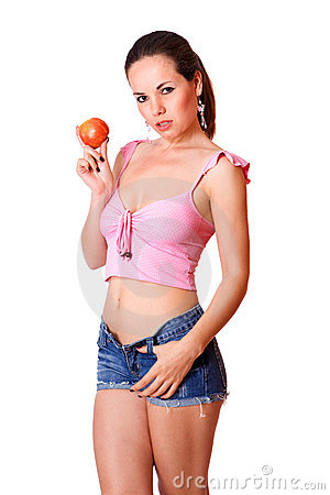 Cute young girl in blue shorts holding an apple