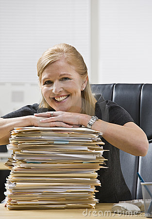 Woman in Office with Paperwork
