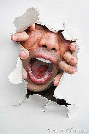 Male mouth screaming from cracked wall