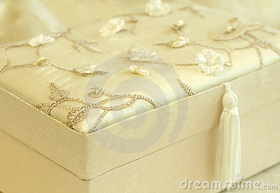 Beautiful gift box sheathed by silk with an embro