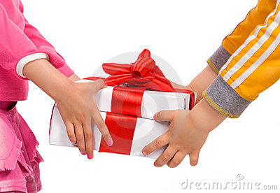 Children's hands with gift boxes