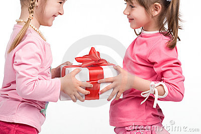 Little girls holding gift boxes