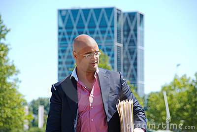 Businessman with files under his arm