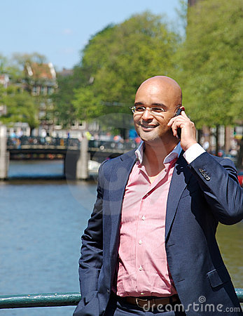 Businessman with phone, on a bridge