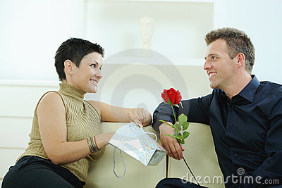 Man giving red rose