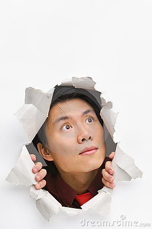 Man looking up from hole in wall
