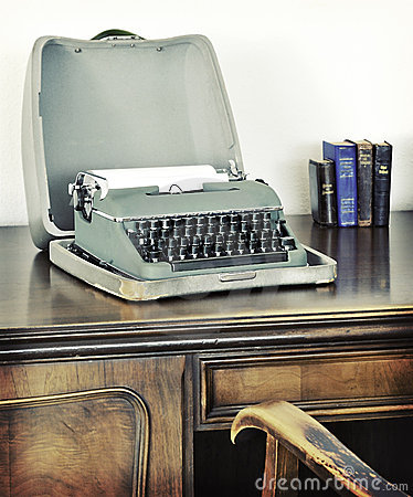 Retro old typewriter on writing desk